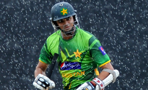 Pakistan batsman Azhar Ali runs as rain falls during the third one-day international (ODI) match between Sri Lanka and Pakistan at the R. Premadasa Stadium in Colombo on June 13, 2012. AFP PHOTO/Ishara S. KODIKARA        (Photo credit should read Ishara S.KODIKARA/AFP/GettyImages)